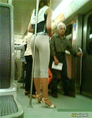 How to hold unto train - Funny way to sit stand on the train . Pretty girl holding unto train in a funny way . Girl with white sandles .
