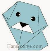 Bước 11: Vẽ mắt, mũi để hoàn thành cách xếp con chó con bằng giấy theo phong cách origami nghệ thuật.