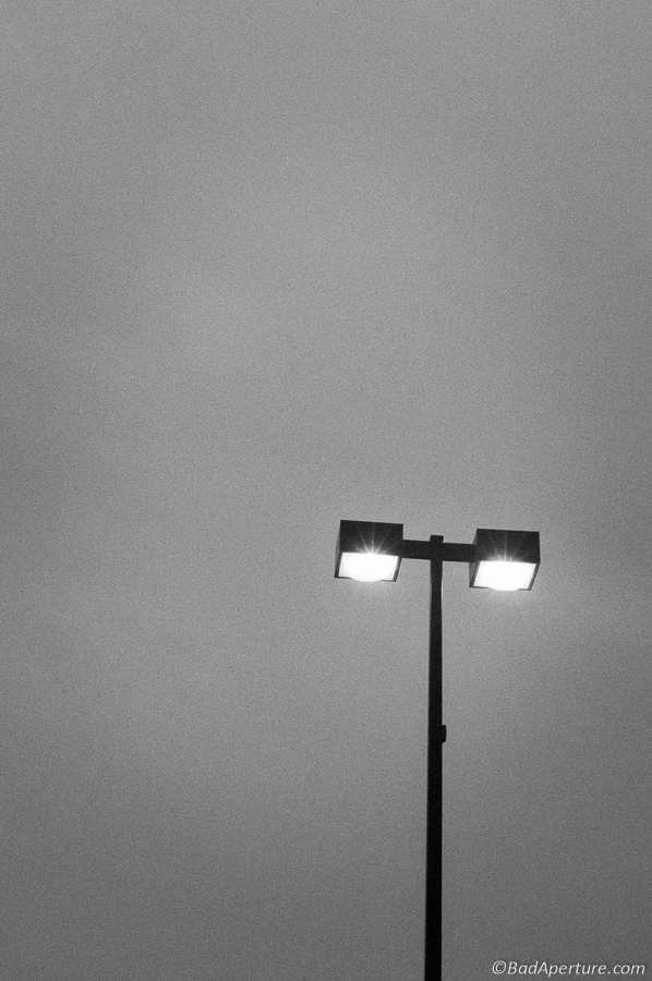 Minimalist street lamp in grey sky