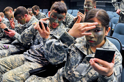 Soldiers Apply Camouflage Make Up