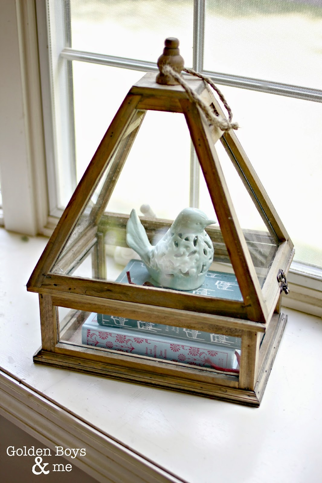 HomeGoods Terrarium with books and bird-www.goldenboysandme.com