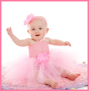 Photo of beautiful baby girl in rose dress