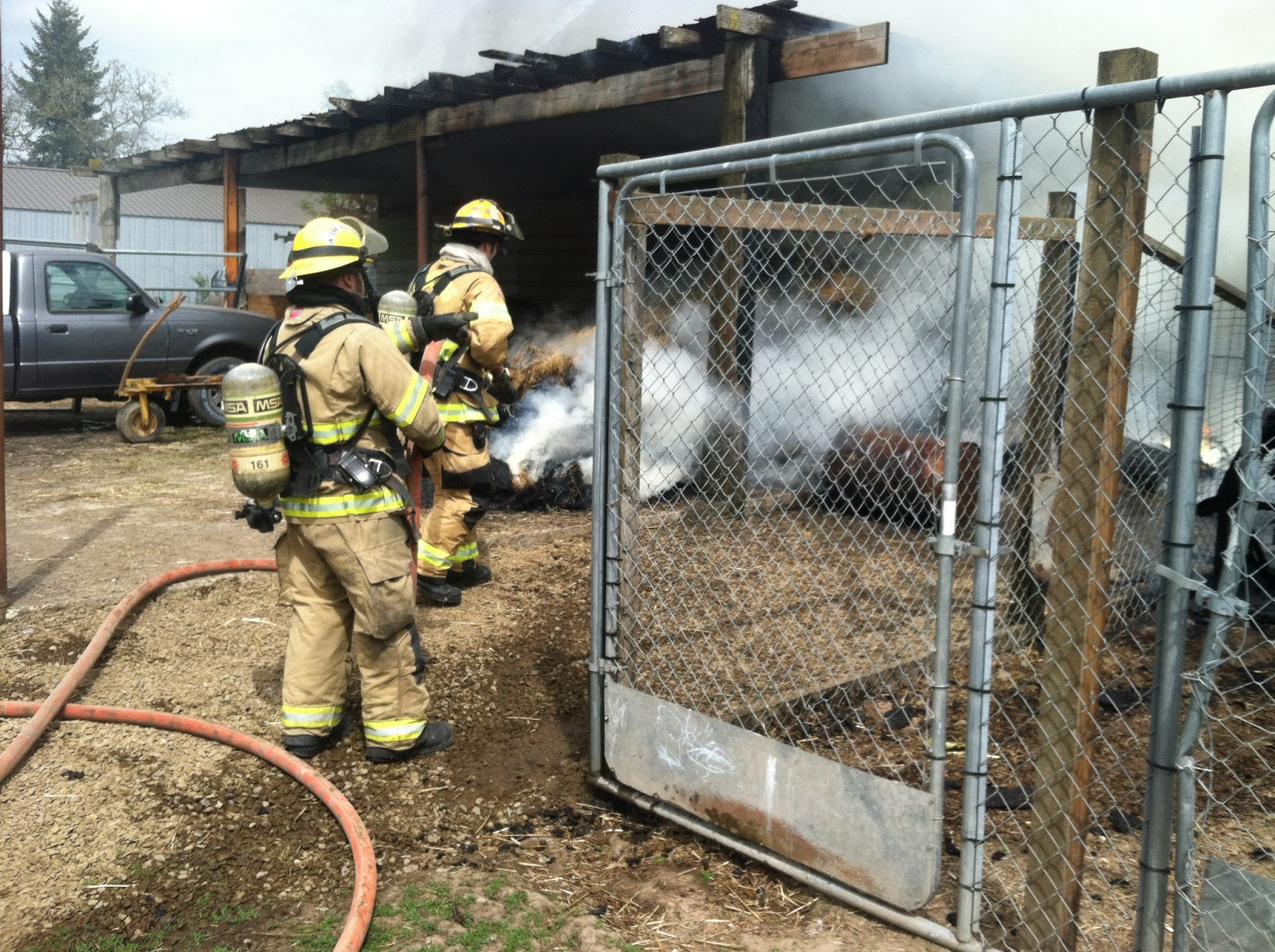 Forest Grove Backyard Burning :  burning hay kept firefighters from accessing some parts of the burning