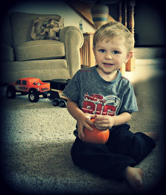 Carter and his pumpkin.