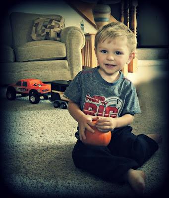 Carter and his pumpkin.