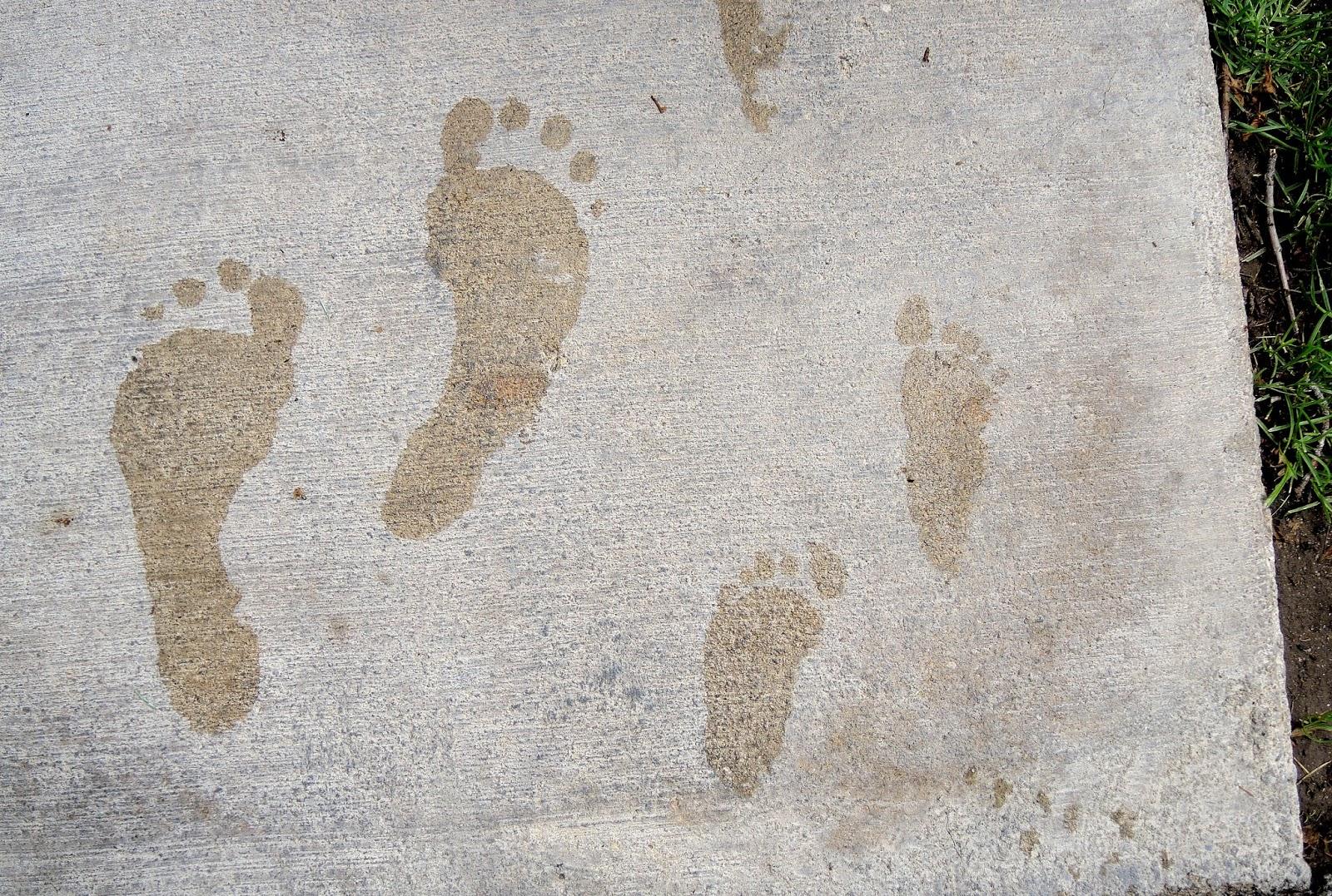 Grandma and Carter barefoot footprints.