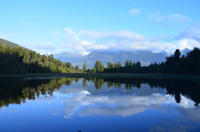 Lake Matheson showing the reflections of Mount Cook and Mount Tasman, in a different hue.