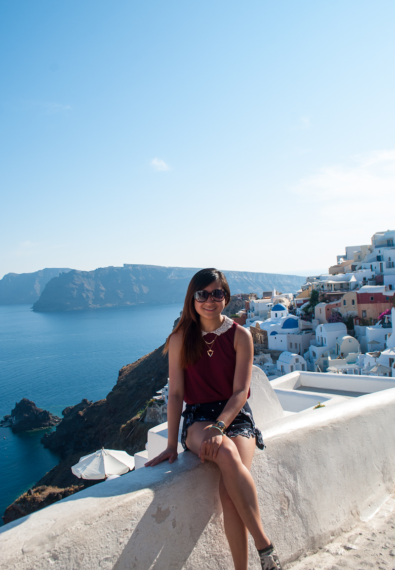 Sitting with the famous santorini oia sunset view