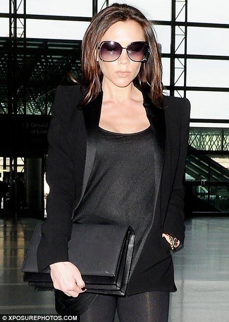 victoria beckham pregnant pictures. Victoria Beckham at Airport