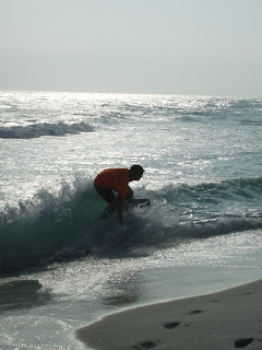 skimboarding a wave at pensacola beach