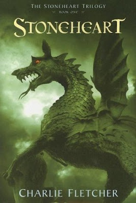 Book cover of Stoneheart by Charlie Fletcher, with a green roaring stone dragon with red eyes.