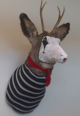 Deer head decorated to look like a mime.