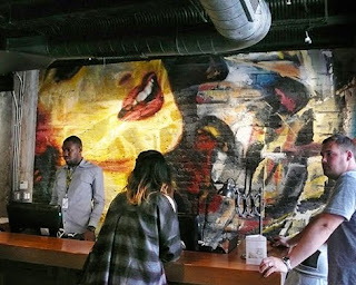 Abstract mural by Brian Tull graces the lobby of the new Acme Hotel.