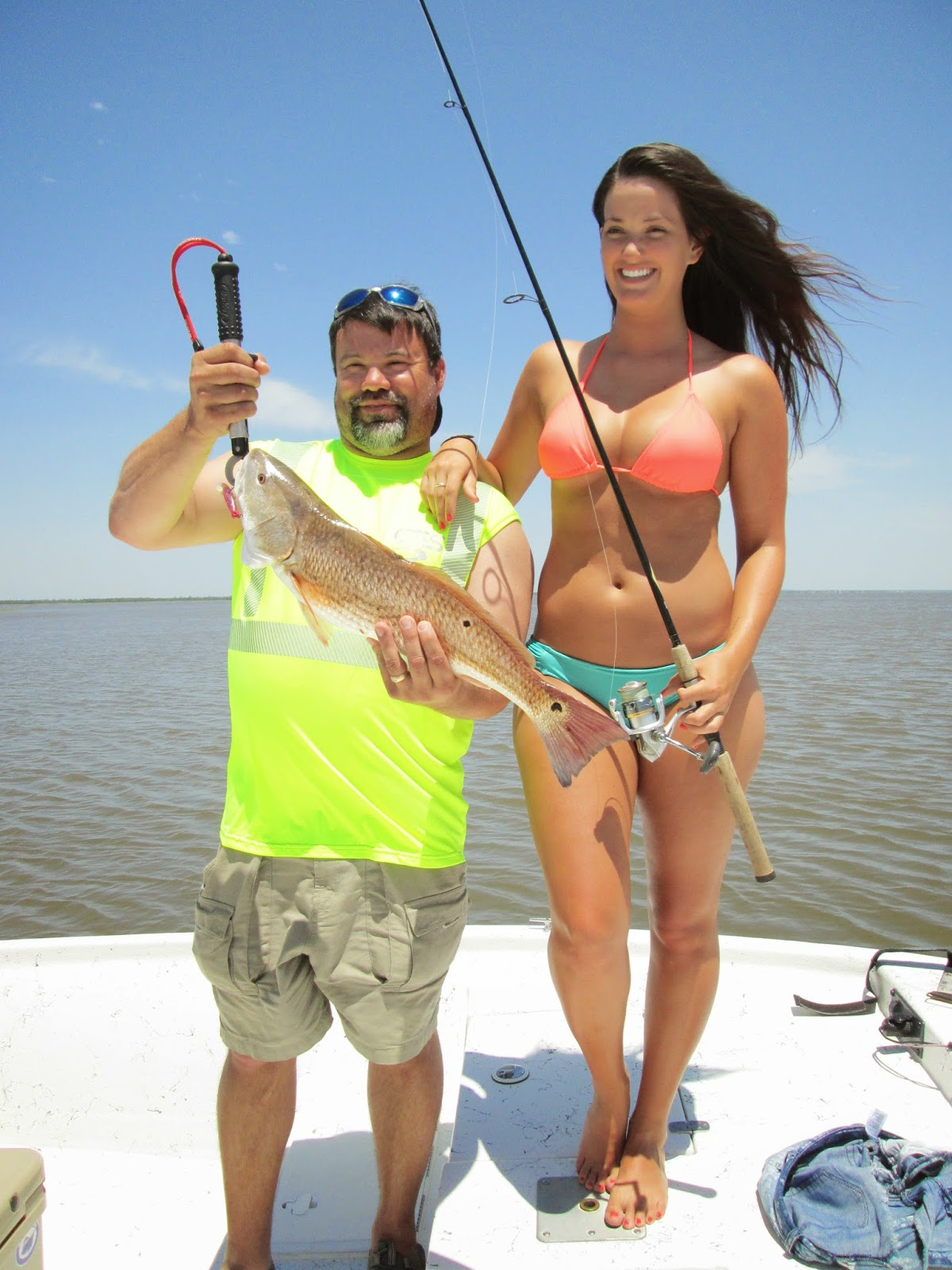 Photos of cute girls in bikinis holding fish for Women fishing in bikinis