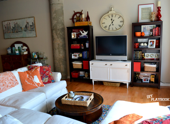 Family room with television white media cabinet bookshelves white couch