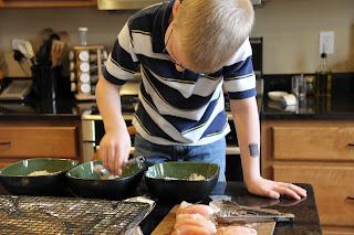 5 year old boy helping to dip chicken tenders