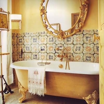 gold clawfoot tub