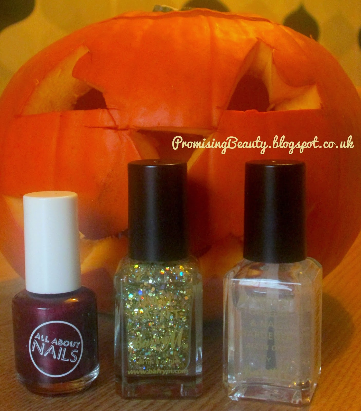 Autumn nail polish, burgundy, oxblood, barry M topcoat and Barry M gold glitter with halloween pumpkin