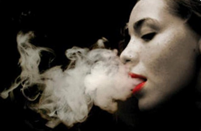 girl blowing smoke plain