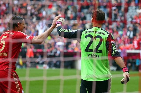 Bayern Munich goalkeeper Tom Starke is congratulated after saving a Nürnberg penalty