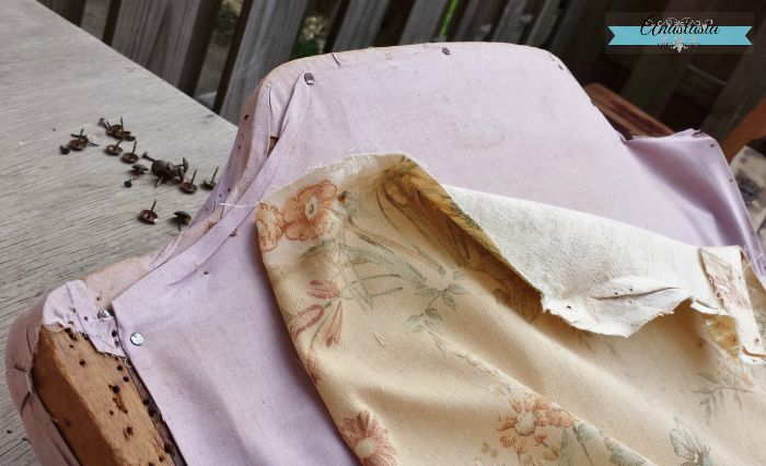 top of vintage rocking chair with pink bedsheet