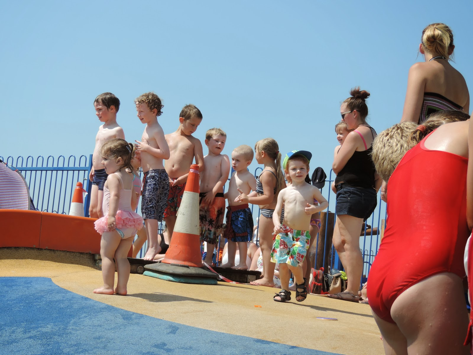 kids lining up for a go on the waterslide first day of the summer holidays