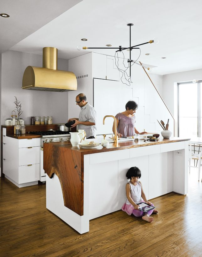 live edge wood kitchen island with brass fixtures