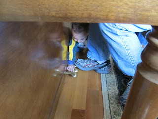 Bean crawling under Daddy's feet, messing with the piano pedals
