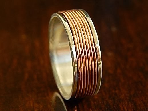 https://www.etsy.com/listing/181117601/coiled-copper-silver-wedding-band-unique?ref=shop_home_feat_1