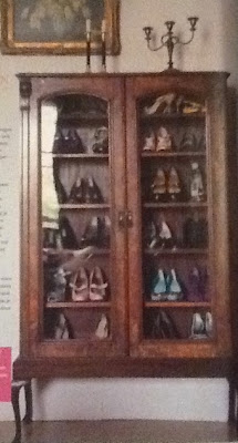 Shoes in an antique cabinet storage