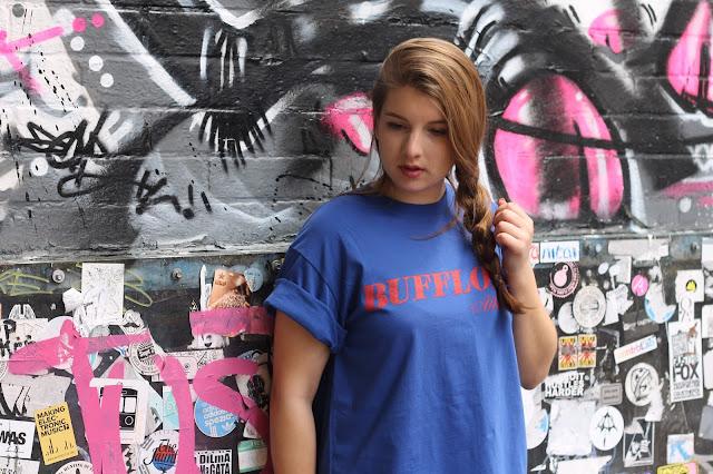 girl in Bufflone Athletic blue t-shirt