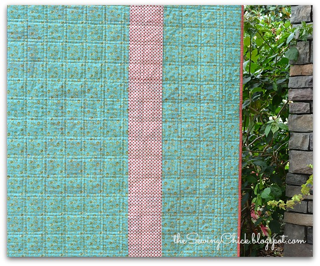 aqua and red quilt back with straight line stitching