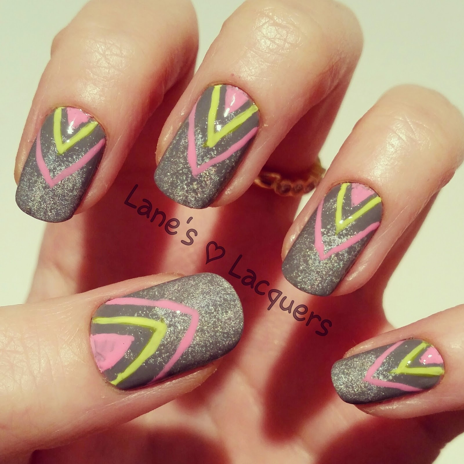grey-holo-base-neon-chevron-freehand-nail-art