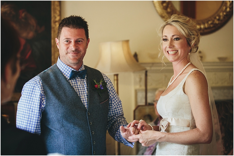 Bride and groom during wedding ceremony in Greenway House