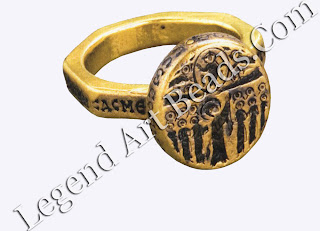 This ring was crafted with Mello and features religious inscriptions. In spite of its small size, the upper part of the ring is the base for elaborate Christian iconography of the ascension of Christ.