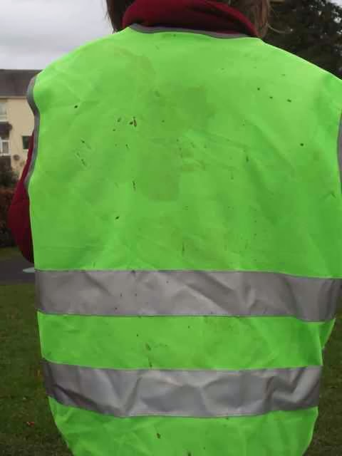 muddy hi-vis vest