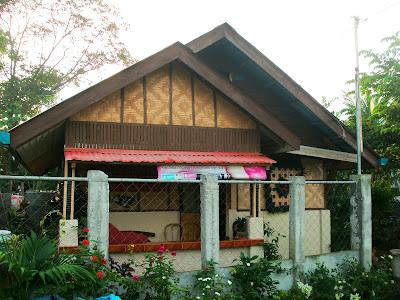 modern version of Bahay Kubo, half concrete, half native materials.