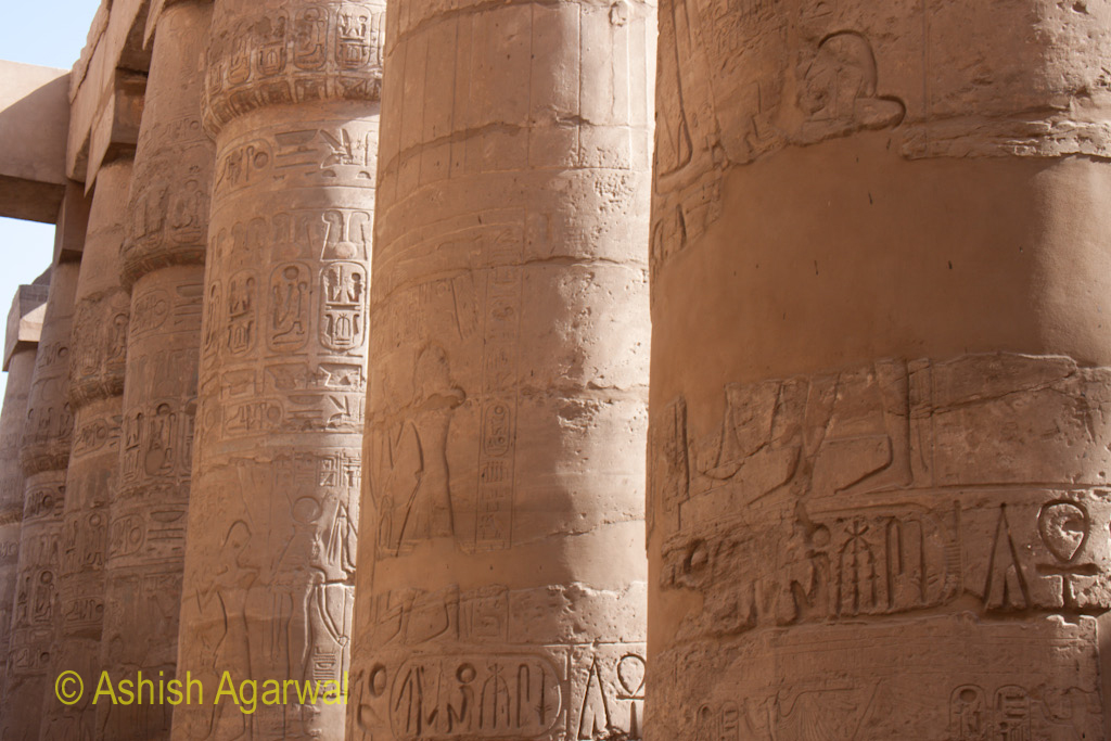 Pillars in a row inside the Hypostyle Hall in the Karnak Temple