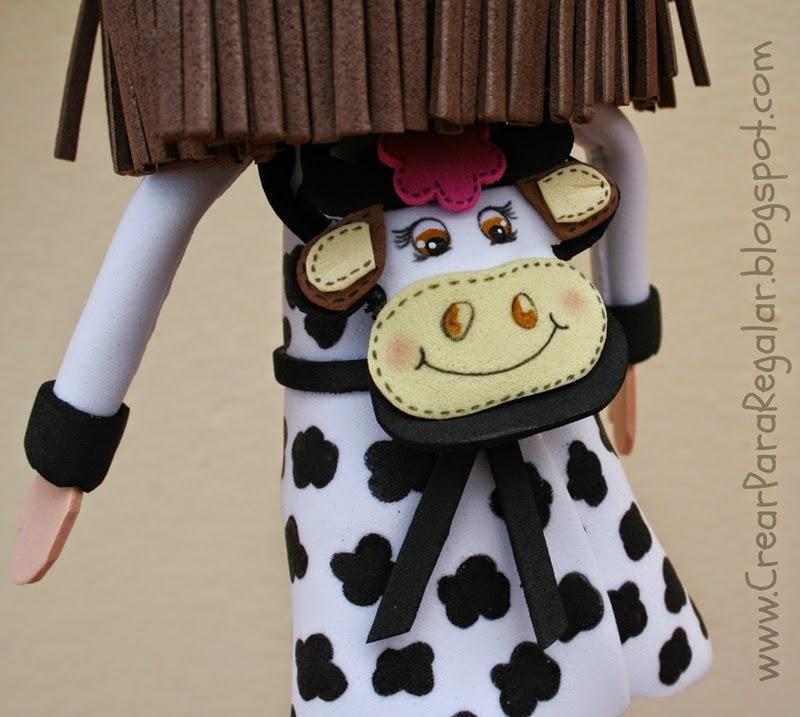 fofucha con mochila de vaca