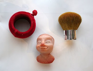 Oil Lamp, Napkin Ring and a Blush Brush