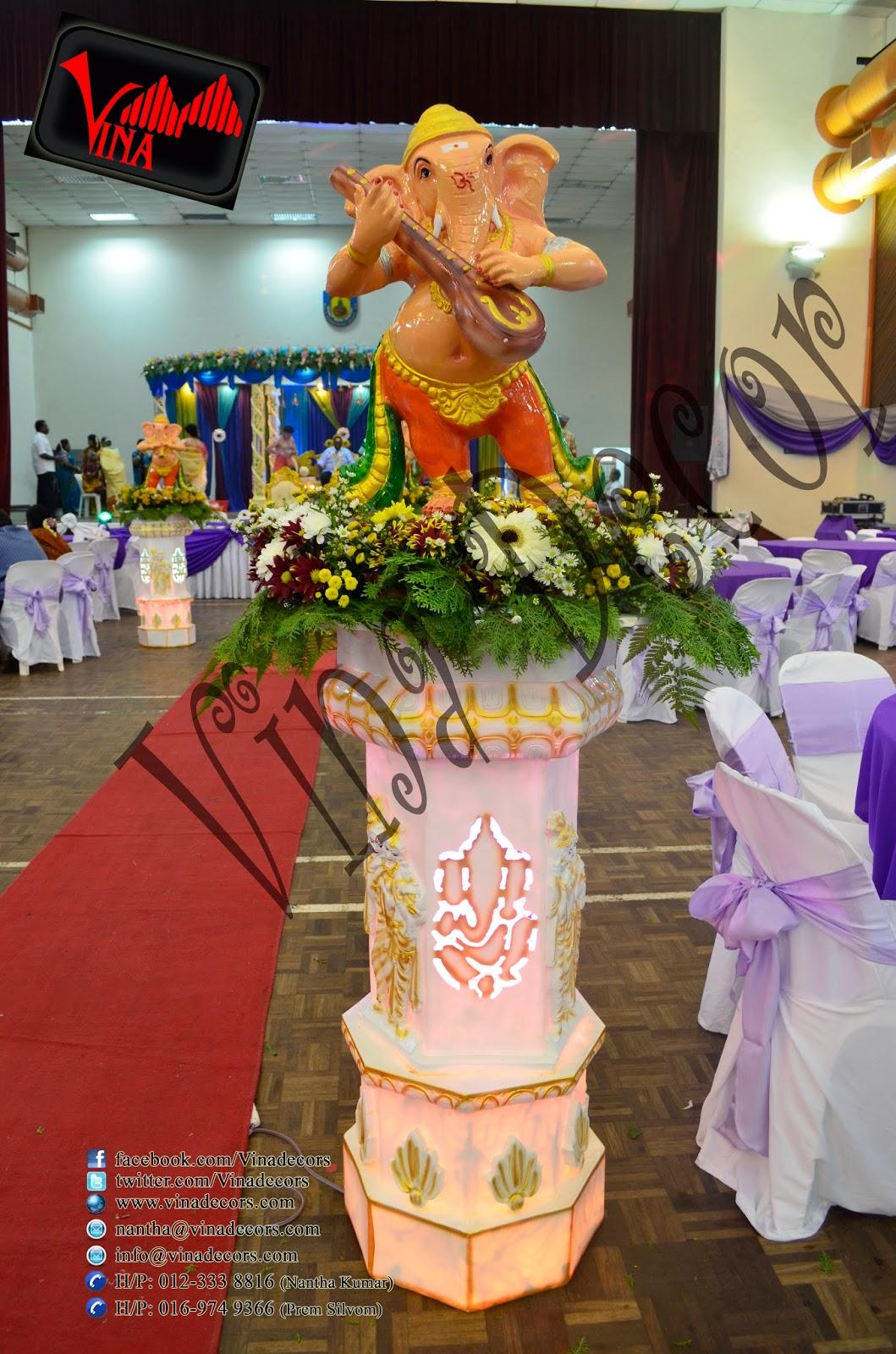 Wedding and Wedding dinner at Dewan Dato Ahmad Razali, Kampung Melayu Ampang, 68000 Ampang, Selangor, Malaysia (Ampang Hall) (Setup for Ganesha Flower pillar, Red Carpet, Stage Scallop and Backdrop with lighting, Manavarai, Crystal Dome Arch chair (cover & ribbon) and Table (cloth).