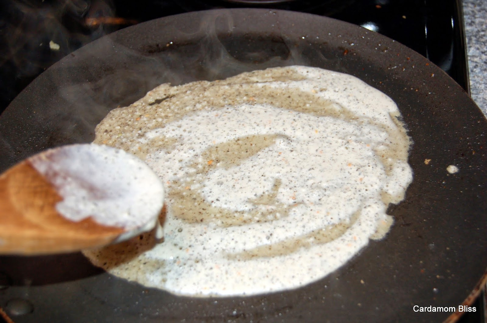 spreading the dosa batter