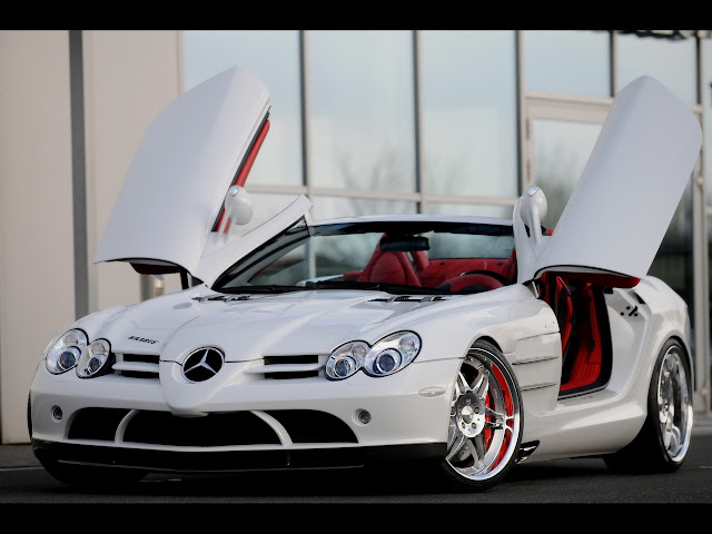 """White McClaren SLR with red interior. How can mike kekel, the CEO of NTCC, a non-profit organization, afford this type of car? His, reportedly, is painted black; and he allegedly doesn't drive it to church so he won't """"put people in a battle"""".... *cough*"""