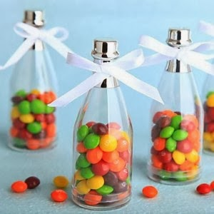 http://www.specialgiftboxes.com/product/champagne-bottle-favor-holder-set-12/