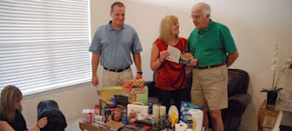 a family prepares a disaster supply kit