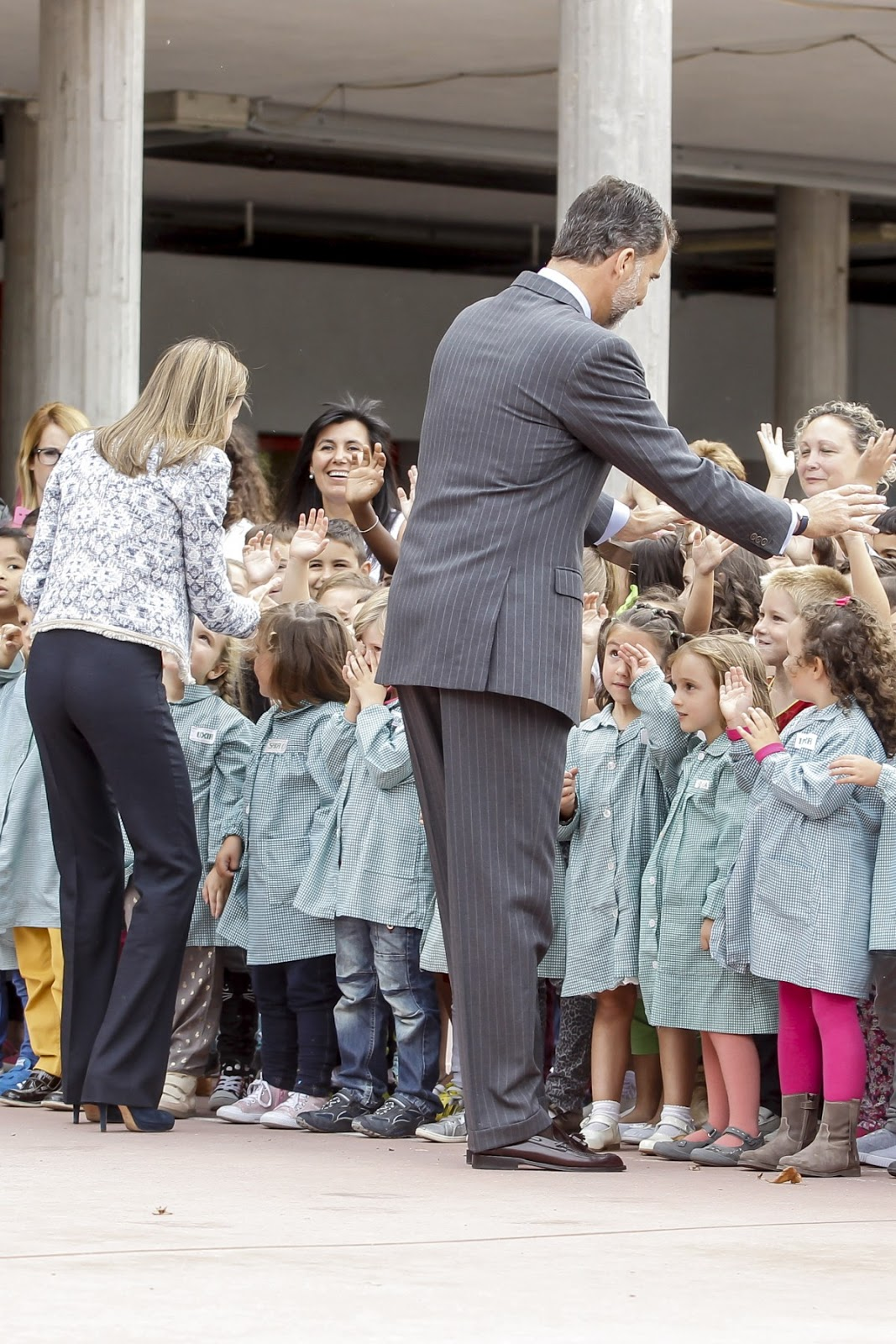Queen Letizia speaks to a young school girl during her visit to the Ben-Cho-Shey school in Ourense.
