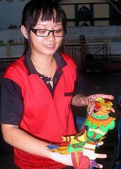 Winning entry: Chan showing her wayang kulit character.