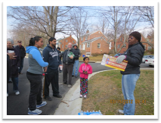 Field Staffer Joyce Fountain speaks with community walk participants.