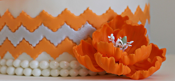 A vibrant orange and damask 60th birthday cake The Couture Cakery