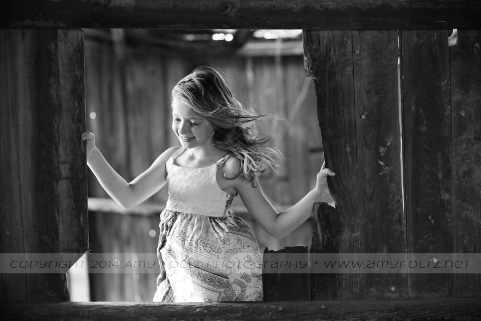 photo of a young girl inside an old barn